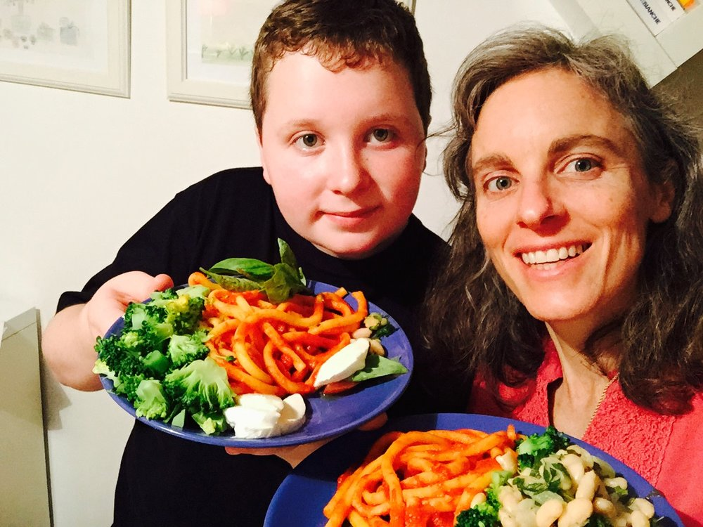 Paula and her son enjoying a home cooked meal   they prepared during their trip to Italy.