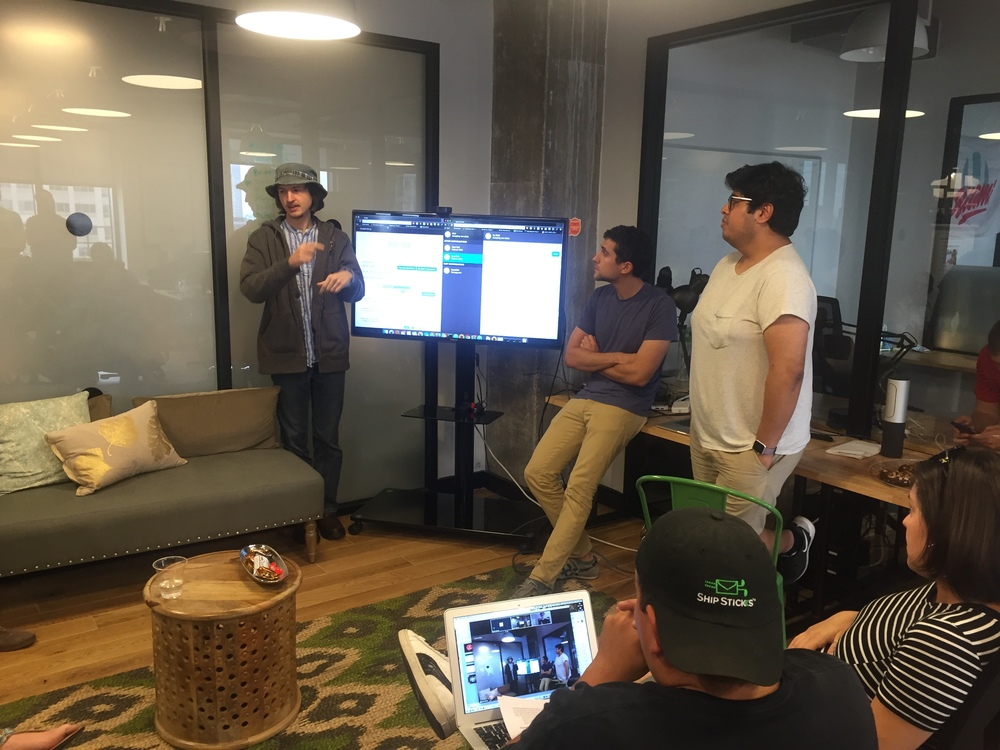 Matt W, Saba and Diego present their idea to the hackathon crew.