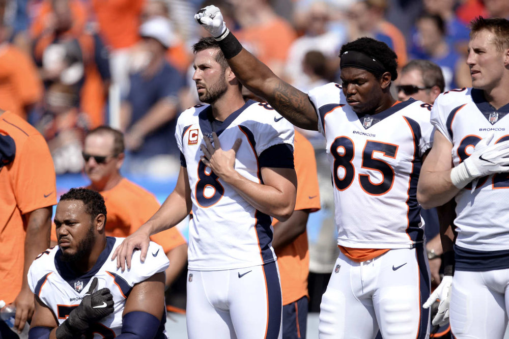 Denver Broncos players demonstrate in solidarity during the national anthem at Sunday's game against the Buffalo Bills. Photo: Adrian Kraus/AP