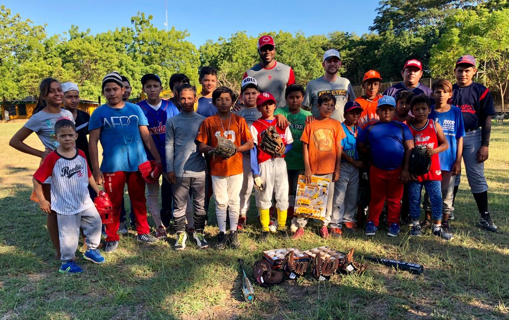 John Mayberry Jr. and Jed Lowrie donate baseball supplies and play a friendly game at an after school program in Managua. Photo by Milessa Lowrie.