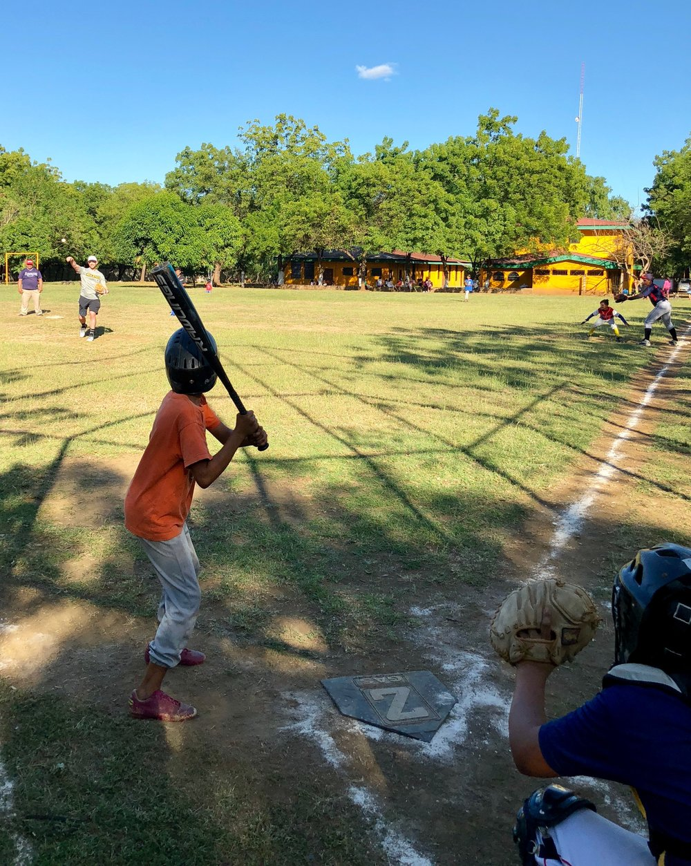 Lowrie pitches during a friendly game with kids in Managua. Photo by Milessa Lowrie.