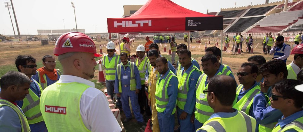 Migrant workers at World Cup construction site in Qatar. Image from FIFA.COM website (copyright LOC)