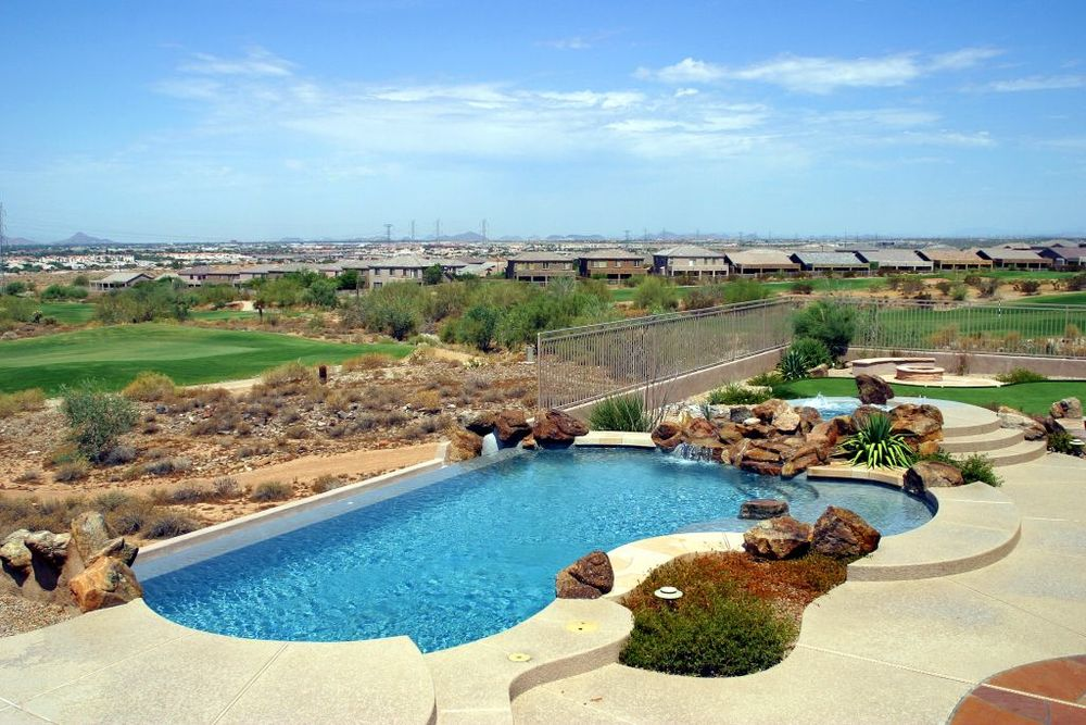 Infinity edge swimming pool gallery presidential pools spas patio of arizona - Infinity edge swimming pool ...