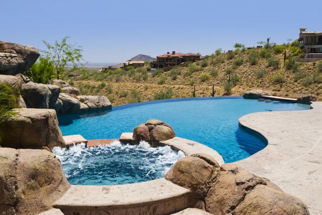 Infinity edge swimming pool gallery presidential pools for Pool design phoenix