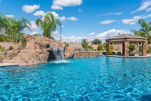 Wide Open Swimming Pool Design with Waterfall Slide Swimup Bar.jpg