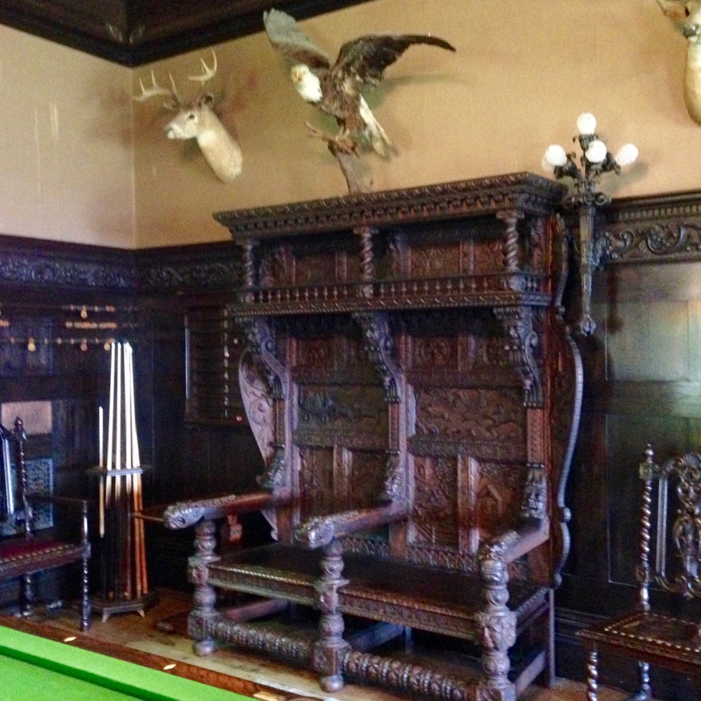 Neo-Jacobean furniture and taxidermy grace the games room