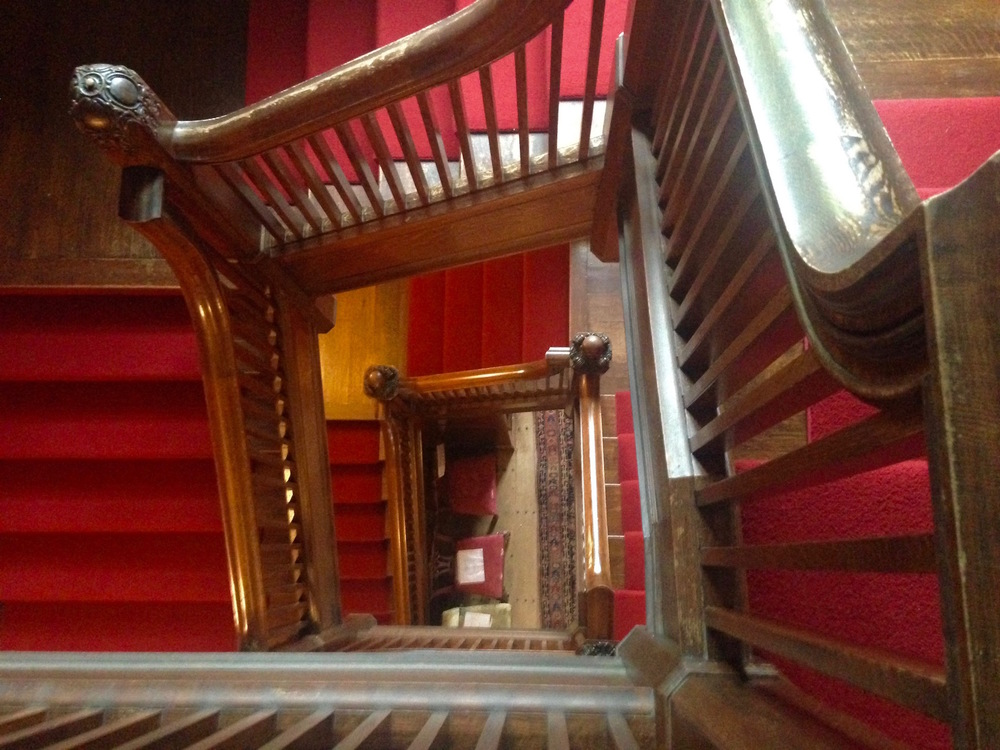 Looking down the staircase from the third floor landing