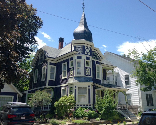 this Queen Anne Victorian's paint job in Newburyport highlighted its stick-style trim really helps it to stand out - the onion dome doesn't hurt either!