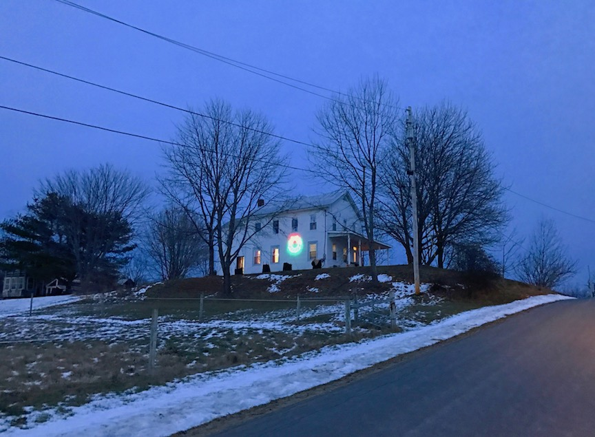 A Big wreath turns this farmhouse on Maple Ave into a living Christmas Card