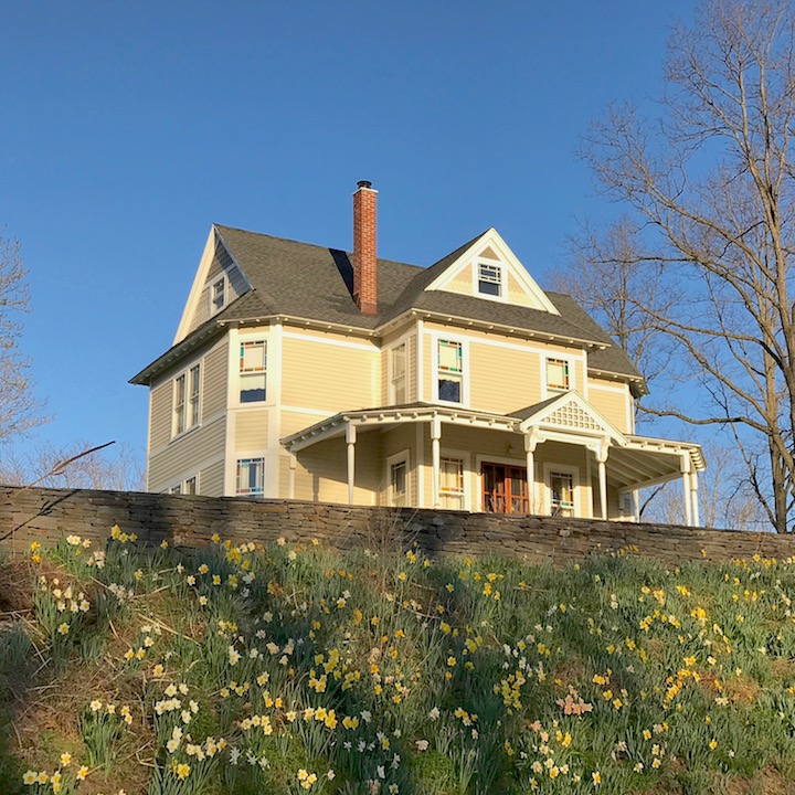 A planting of daffodils accentuate this Queen Anne home in Cheviot