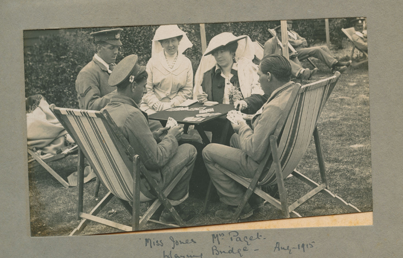 Pauline playing bridge with some convalescing soldiers