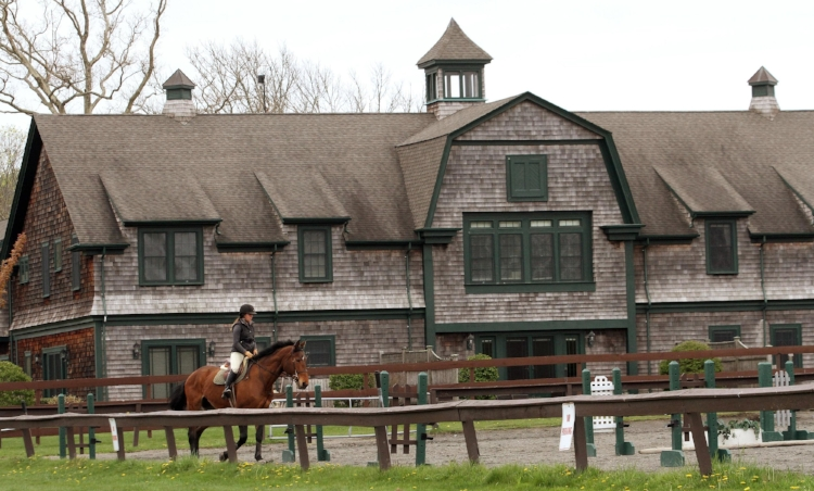 Rider in front of the former stables (now condominiums)
