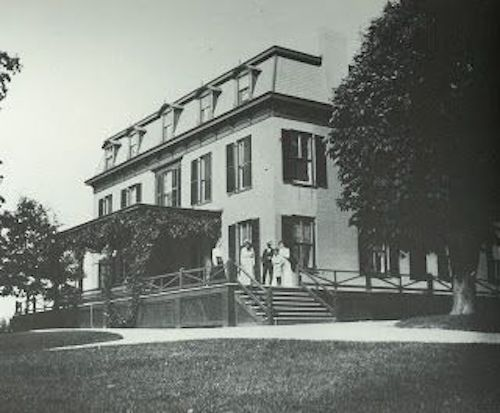 Oak Hill, John Henry's childhood home, expanded in the 19th century with a mansard roof