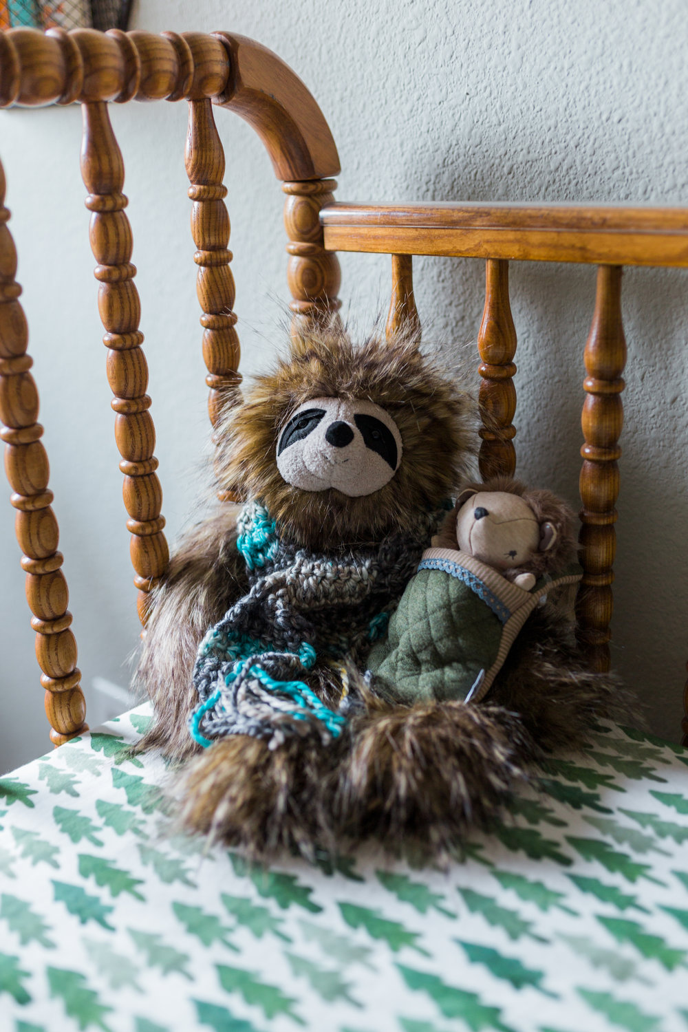 My mom bought this sloth because we saw one together at the Dallas World Museum when she flew here with me in January. Apparently it made her think of Wesley. :) She also made the scarf and a super-cute hat that matches it! Also, I'm obsessed with the sheets!!