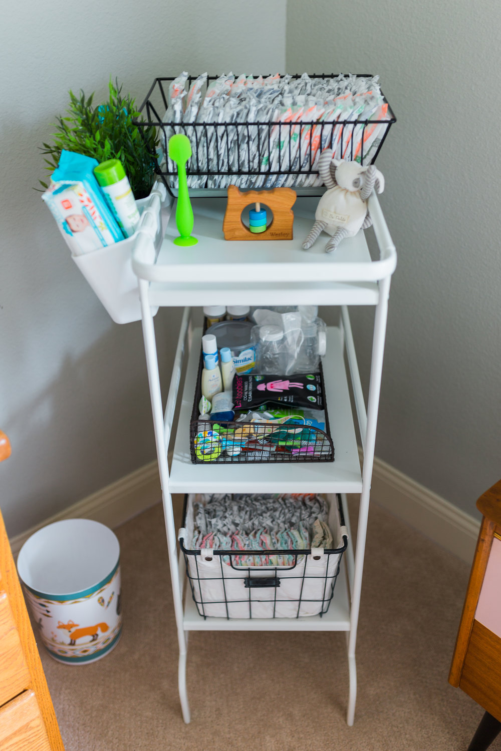 I'm pretty proud of this silly thing. I looked on Pinterest for changing station organization and there's a different IKEA caddy all over the place, but it didn't come in a color I liked! I found this one in their laundry area for half the price (and it's larger), the diapers on top are in a plate drying rack (ha!) and the little buckets on the side and baskets were add-ons. It's filled with all sorts of diaper supplies and TONS samples I've received from various companies (all of the diapers and wipes in the caddy were even free!).