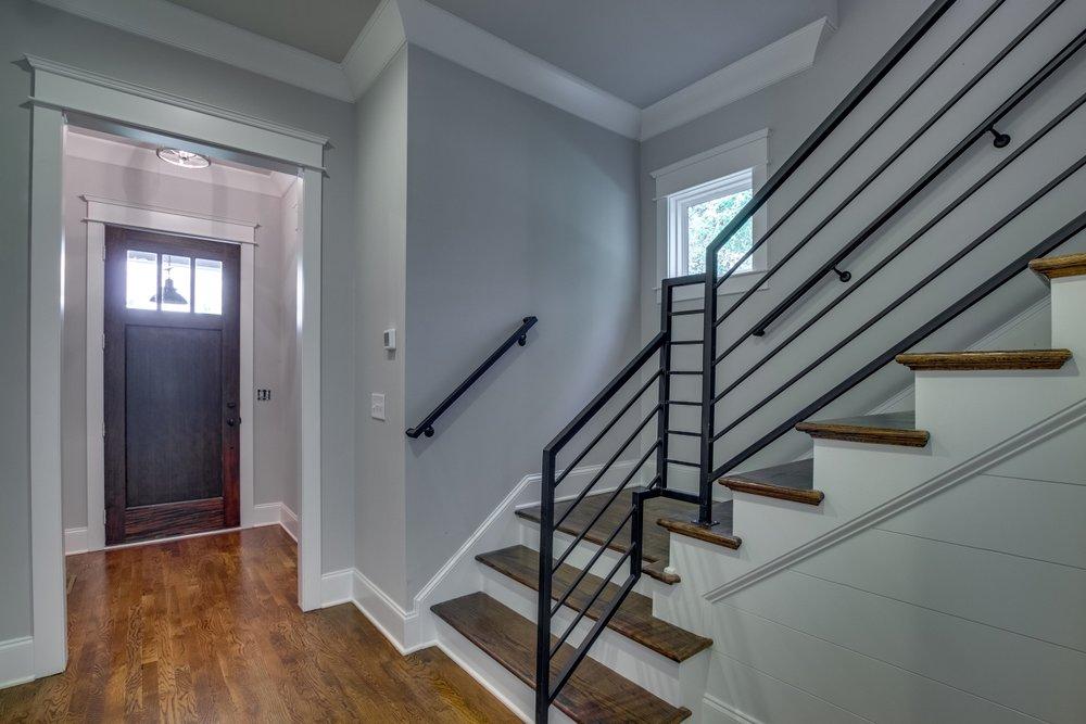 House-Plans-Online-Narrow-Nashville-Peggy-Newman-Entry-Stairs-Iron-Kimbark.jpg
