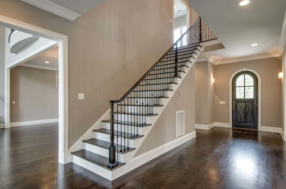 House-Plans-Online-Selections-Nashville-Peggy-Newman-Finishes-Entry-Stair-Railing-Iron-Arch.jpg