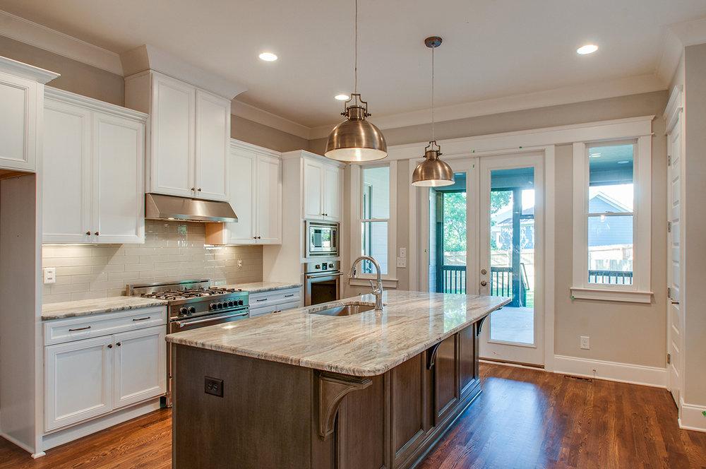 House-Plans-Online-Nashville-Peggy-Newman-Tudor-Kitchen-Large Island-Overhill.jpg