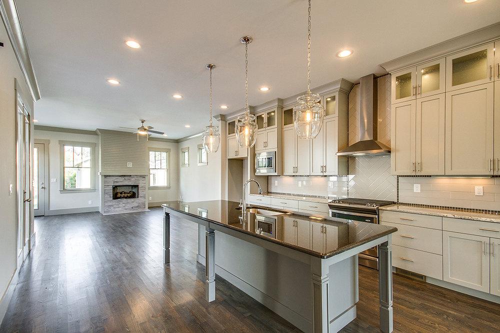 House-Plans-Online-Nashville-Peggy-Newman-Tudor-Fireplace-Great Room-Kitchen-Family-Primrose.jpg