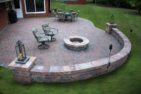 Brick floor patio with outdoor chairs in front of a brick fire pit - Premier Lawn Care Nashville