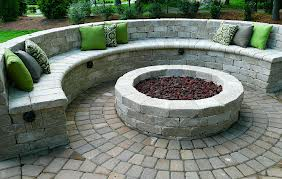 Outdoor half circle stone seating around a brick fire pit - Premier Lawn Care Nashville