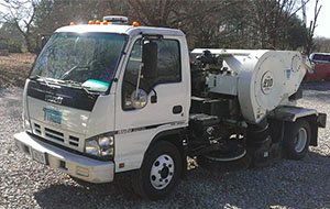 White parking lot cleaner truck - ParkingLot Services Premier Lawn Care Nashville