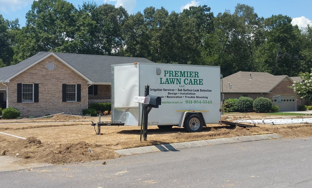 Sprinklers watering a lush, multi-level yard - Irrigation services from Premier Lawn Care in Nashville
