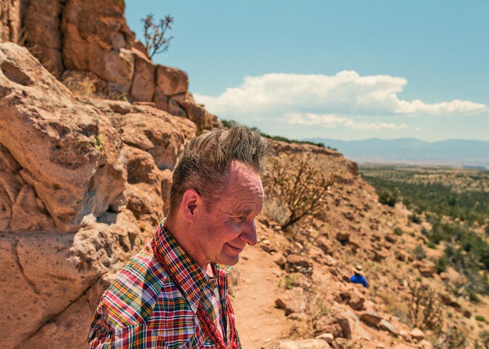 Peter Sellars exploring the Puye Cliff Dwellings in Santa Clara Canyon on Santa Clara Pueblo land near Española, New Mexico.
