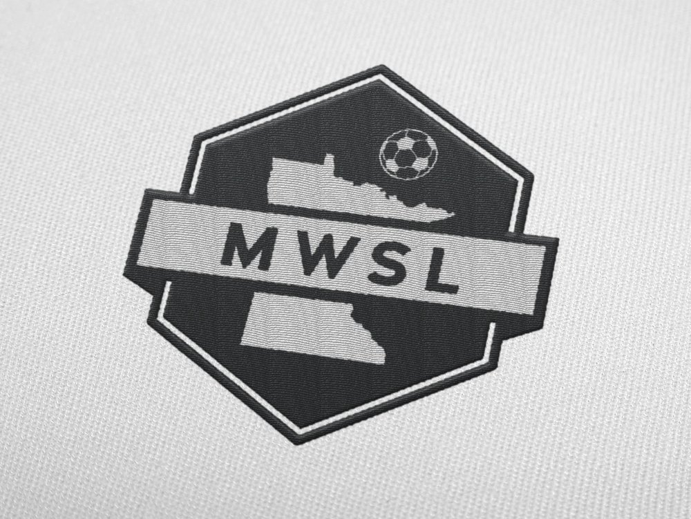 I took into consideration classic symbols of the sport (the badge and hexagonal shapes found on a soccer ball) to create a more modern and concise image of the organization.