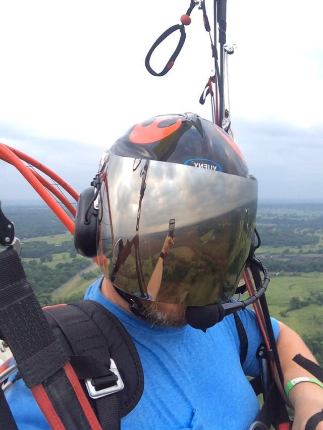 Up, up and away.  Phone, Apple.  Paramotor, Dudek Hadron.  Beard, model's own.  The going's good for now, eh Trent?