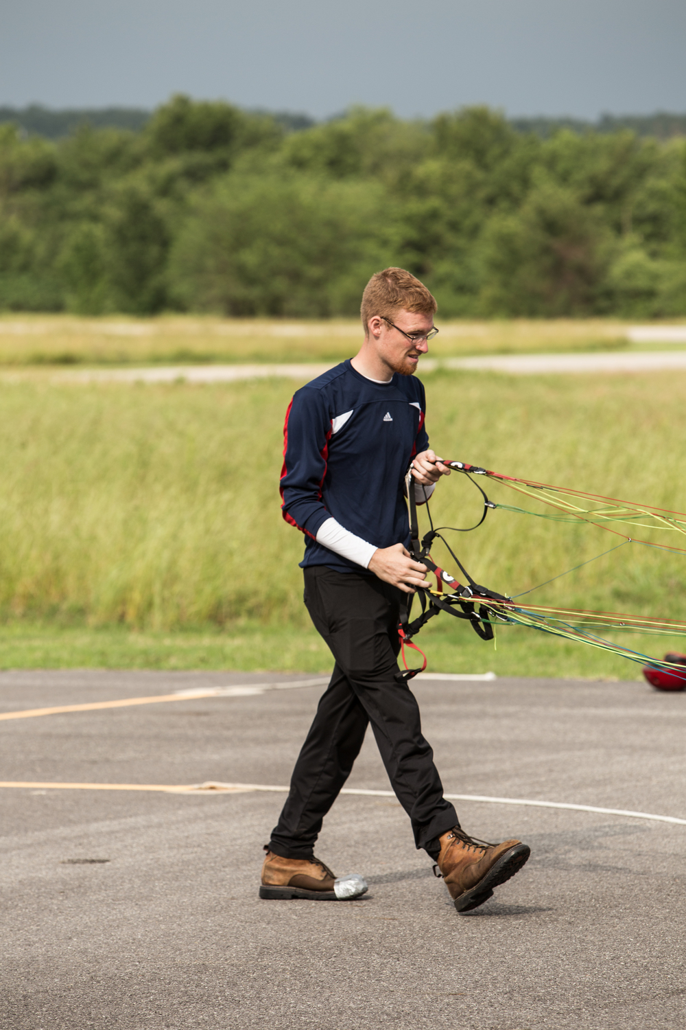 Portrait of Ian. Silver toed. Paramania winged. Pianist fingered.  A picture of elegance on the tarmac