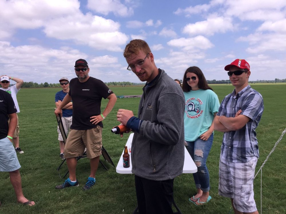 Ian, freshly landed and crowned race class winner, prepares to hand in his tracker, and hand out some tales of adventure to the baying crowds clamouring to share his epic victory