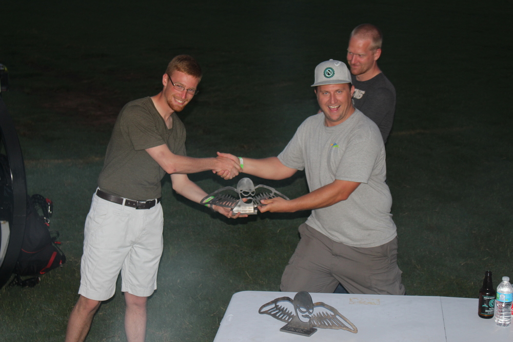 Ian accepts the inaugural Icarus X Race Class trophy from Adventurists Shane.  Adventurists Aneurin looks on admiringly.  Creepily, some might say