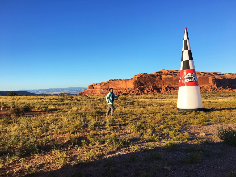 Adventurist Lara, grounded by a twisted ankle from previous flight, officially crosses the finish line, Moab UT.