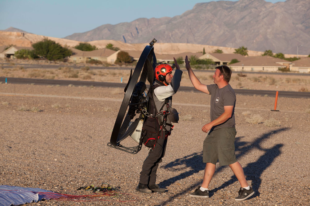 Tucker Gott crosses the Race Class Finish Line and high fives Race Director Shane Denherder.      Tucker won the Icarus Trophy 2017, flying over 1000 miles in 5 days, completely unsupported.