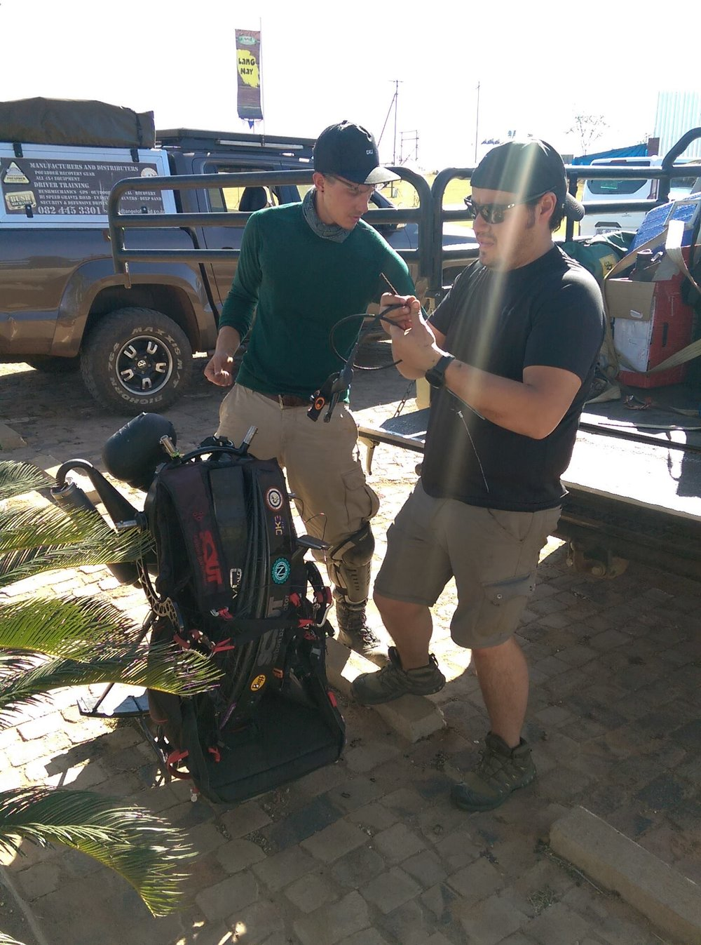 I discovered that I could scavenge parts off the paramotor of Austin. I wasn't the only one. Here Kevin and Miguel strip the throttle cable to replace the one Kevin broke on a take off attempt. Thanks again Austin!