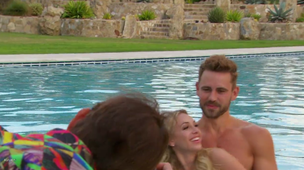The face of a man realizing holding one topless woman is making the other 11 women on the date very unhappy. Been there, right guys?