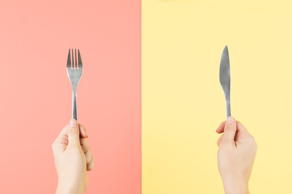 fork-and-knife-in-hands_4460x4460.jpg