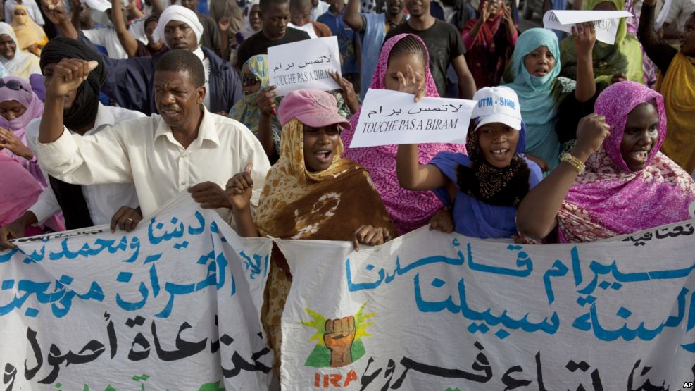 Photo: AP, activists march for freedom for Mauritanian anti-slave leader Biram Dah Abeid