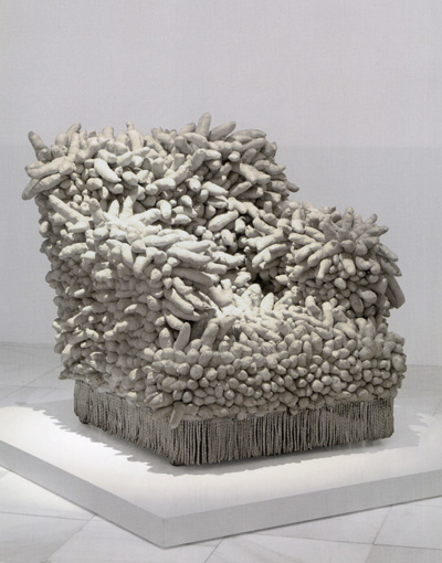 Kusama's Accumulation 1 (1962), sewn stuffed fabric, paint, and chair fringe. The Museum of Modern Art, New York.