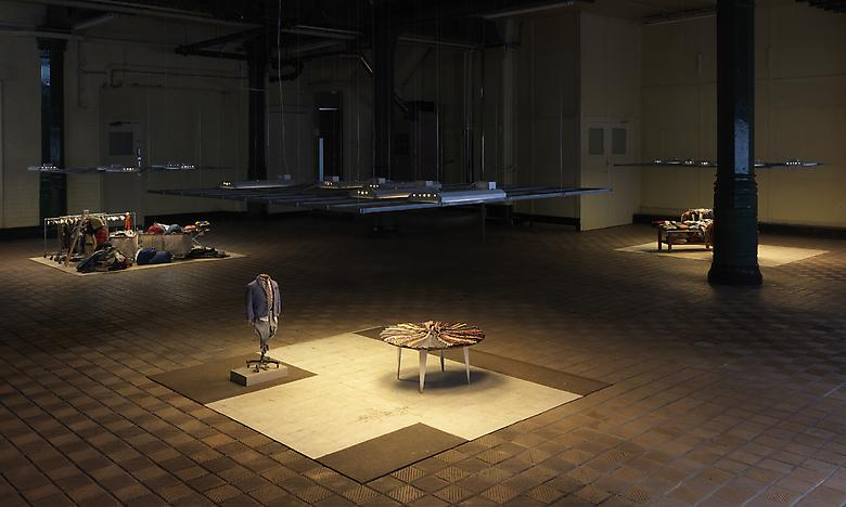 Charles LeDray's installation work,  MENS SUITS  (2006-2009)