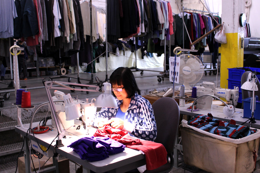 Expert sewer, Trang mends garments for shoppers