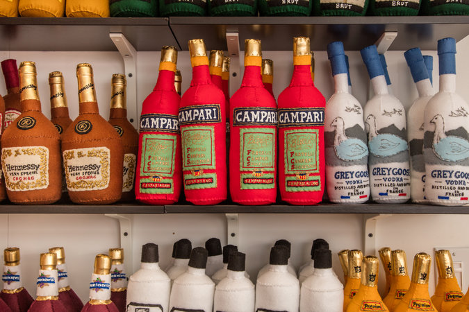 Felt booze on the shelves in Lucy Sparrow's installation 8 'Till Late.Photo: Tony Cenicola/The New York Times
