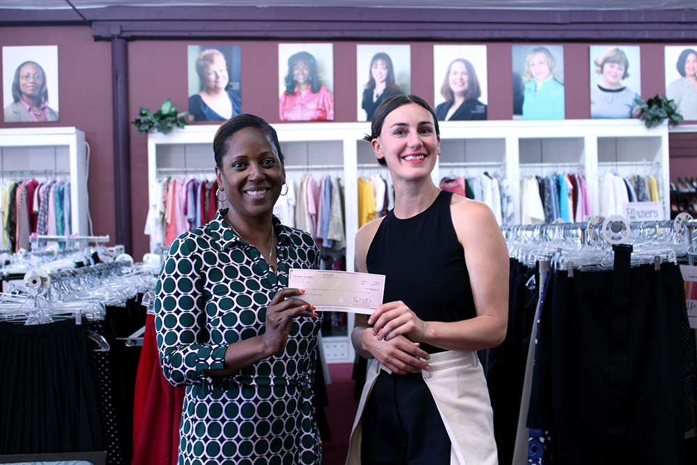 Britt delivering the EILEEN FISHER check to Shari Dunn, Executive Director of Dress for Success Oregon