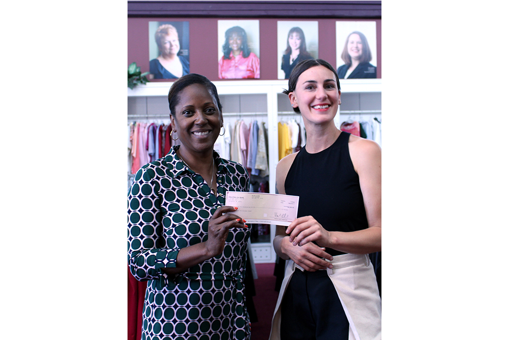 PGF's Britt Howard delivering the EILEEN FISHER check to Shari Dunn, Executive Director of Dress for Success Oregon
