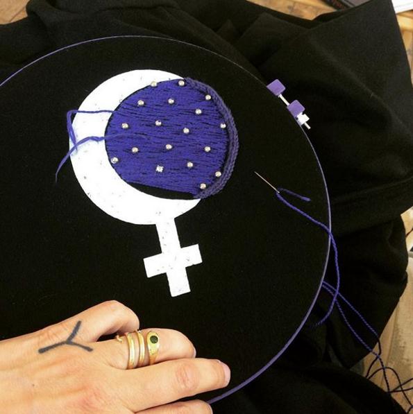 Ellen hand embroidering her cloaks. Image: @ellenlesperance