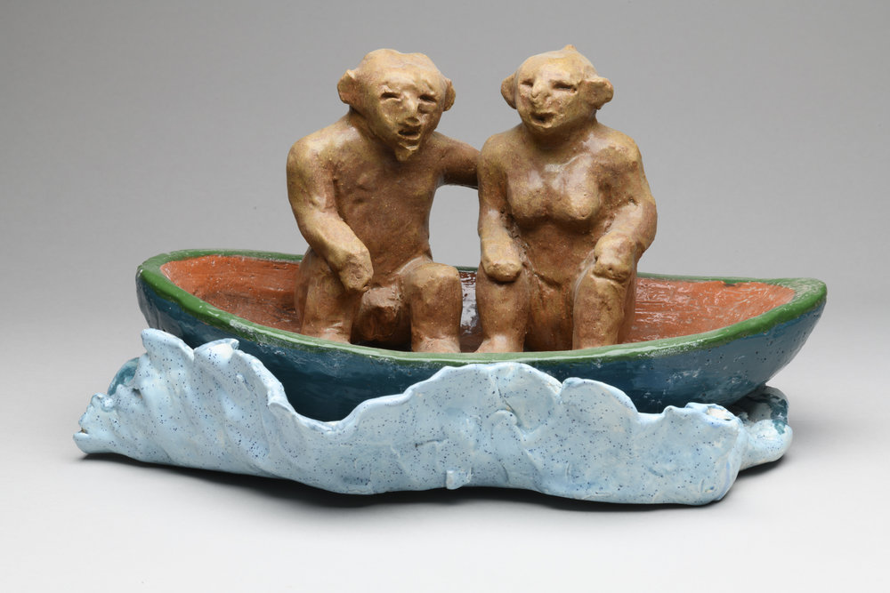 Mud figures in a Boat