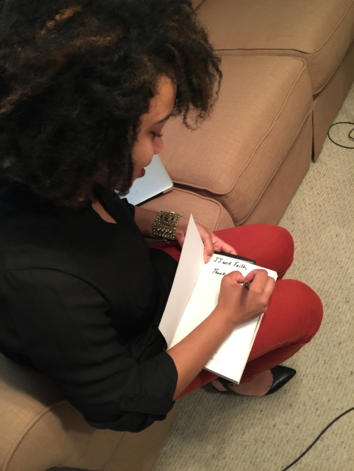 Kielah signs a book for thePlatform314.