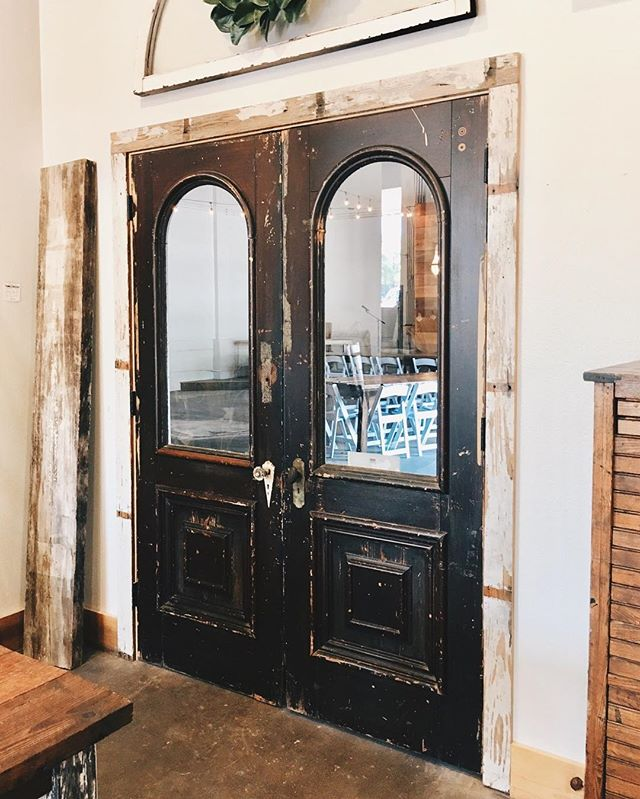 A set of antique doors leading out of the Tumbleweeds space and into @thestationmckinney. We're open from 10-5 tomorrow. Pop in to shop and get a peek of the venue space, too! #historicmckinney #downtownmckinney #tumbleweedssalvage