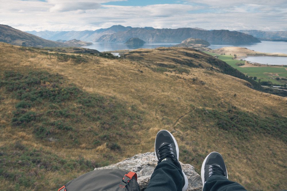 Sitting on a cliff overlooking Lake Wanaka. Source -  @andymiao.jpeg